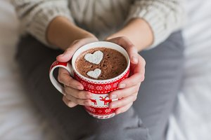 Woman hands holding a Cup of hot cocoa or  chocolate for  background, traditional drink  the winter time, lifestyle photos, top view, Valentine's day