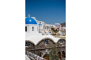Santorini, Greece - White church with blue dome on blue sky background