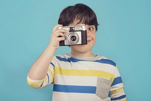 smiling boy with photo camera