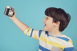 Smiling child taking selfie photo