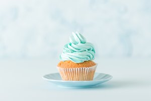 Cupcake with blue cream.