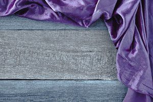 The purple cloth on a wooden board