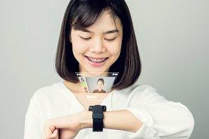 Woman use digital clock displaying.