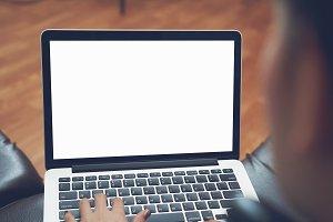 woman uses an empty laptop screen.