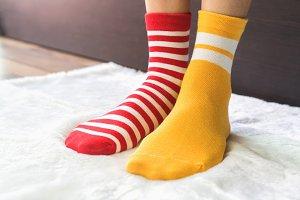 Legs in socks two colors alternate.