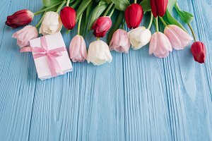 Pink, red, white tulips and gifts
