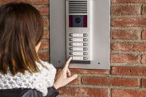 Woman talking on the intercom