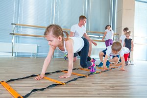 Happy sporty children in gym. Kids exercises