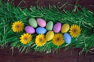 Colorful Easter eggs on grass.