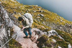 Climber man climbing in mountains