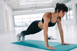 Fit and strong woman doing push ups