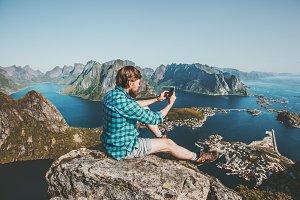 Man traveler using smartphone sittin