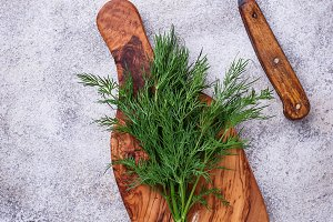 Fresh dill on cutting board