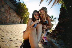 Cheerful female friends having fun
