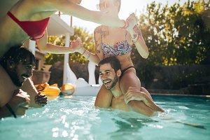 Couples having fun in swimming pool