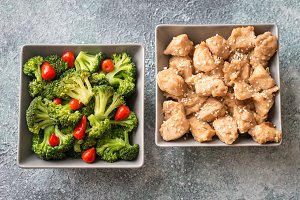 Bowls of broccoli and chicken stir-