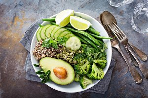 Green vegan lunch bowl with quinoa and avocado