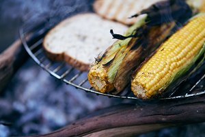 Grilled Corn and Bread on campfire