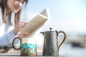 girl drinks coffee and reads book