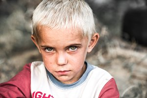 portrait of a little homeless boy
