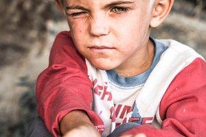 Asking a homeless boy