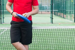 man in the paddle tennis field