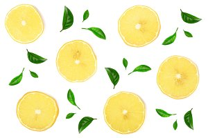 Slices lemon decorated with leaves isolated on white background. Flat lay, top view