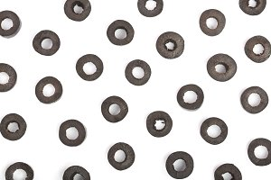 sliced black olives isolated on white background. Top view. Flat lay pattern