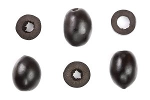 whole and sliced black olives isolated on white background. Top view. Flat lay