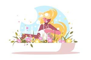 Cute blonde watering home flowers