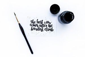 Ink, paint brush, card with quote
