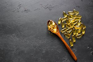 wooden spoon and fish oil