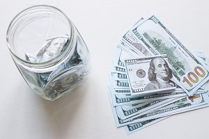 jar with donations and dollars