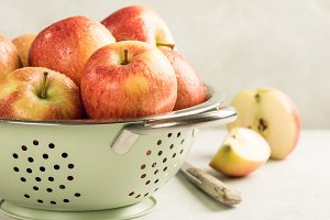 Fresh apples in metal strainer