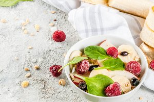 Fruit salad with spinach and granola