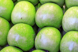 Bunch of green apples in a market