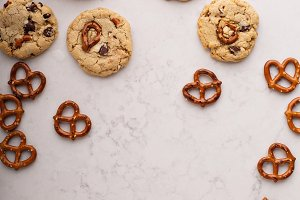 Chocolate chips and pretzels cookies on a marble table
