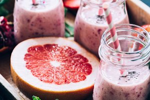 Pink grapefruit smoothie in bottles