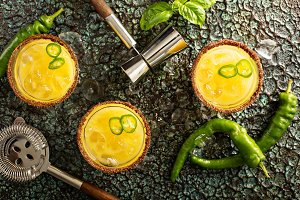 Spicy mango margaritas with hot pepper