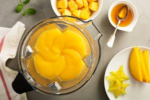 Making smoothie with frozen mango