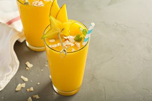 Mango smoothie with honey and coconut