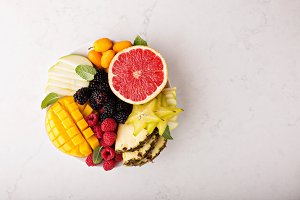 Fruit plate with mango, grapefruit and berries