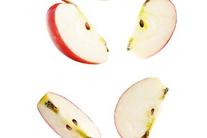 Falling sliced apple isolated