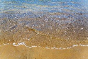 Gentle waves on tropical sandy beach