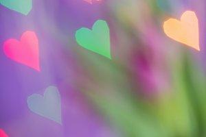 Defocused bokeh light hearts