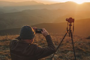 Nature photographer in mountains