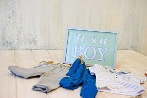Sign with text and baby clothes
