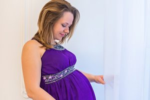 Beautiful pregnant woman standing