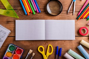 Desk, school supplies, squared paper, wooden background, copy sp