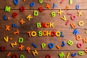 Colorful plastic letters, numbers, back to school,  wooden backg